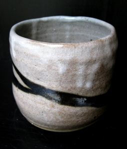 See the snowy shino glaze and the black stripe that cuts through it...
